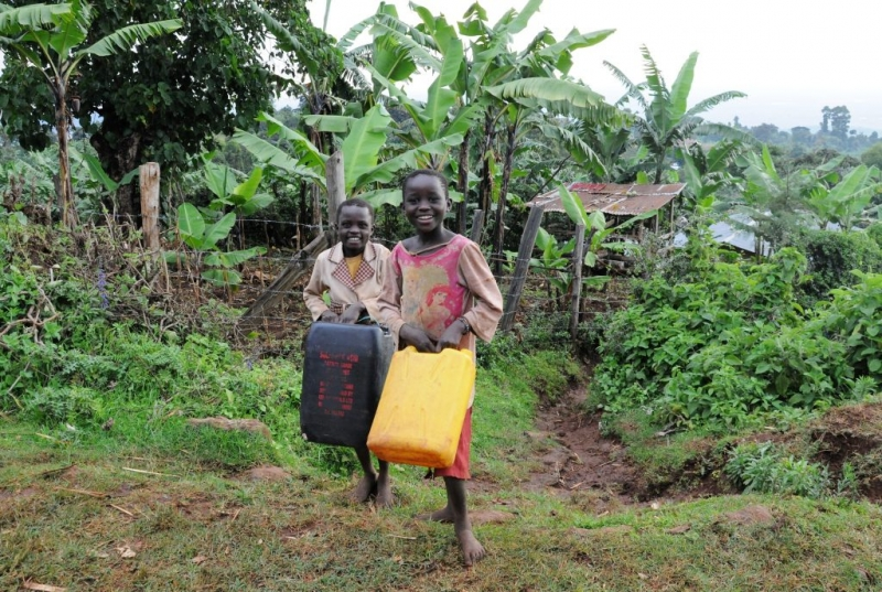 Jacynth and Ruth on their way to fetch water
