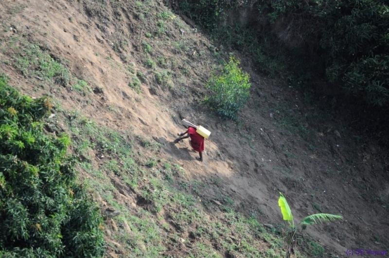 littel girl fetching water, Lake Kivu